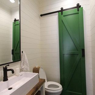 ダラスの小さいトランジショナルスタイルのおしゃれなトイレ・洗面所 (横長型シンク、木製洗面台、白い壁、濃色無垢フローリング、オープンシェルフ、ブラウンの洗面カウンター) の写真