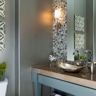 Photo of a classic cloakroom in Austin with a vessel sink, freestanding cabinets, blue cabinets, multi-coloured tiles, mosaic tiles, grey walls and brown worktops.