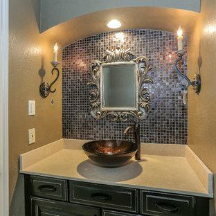 Ispirazione per un bagno di servizio con ante con bugna sagomata, ante marroni, piastrelle multicolore, piastrelle a mosaico, pareti gialle, pavimento in gres porcellanato e lavabo a bacinella