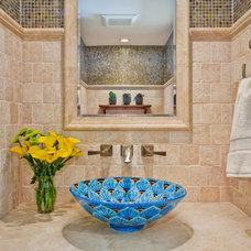 Mediterranean Powder Room by Jackson Design & Remodeling