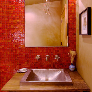 Inspiration for a contemporary mosaic tile and red tile powder room remodel in Sacramento
