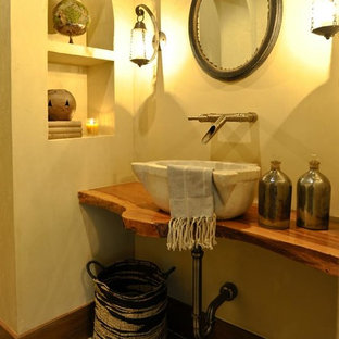 Design ideas for a medium sized rustic cloakroom in Other with a vessel sink, wooden worktops, multi-coloured tiles, beige walls, cement flooring and brown worktops.