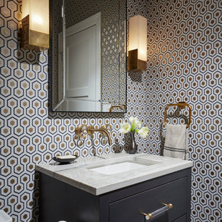Small transitional powder room photo in Chicago with multicolored walls, an undermount sink, marble countertops and flat-panel cabinets