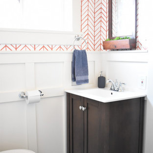 Small contemporary cloakroom in Denver with flat-panel cabinets, dark wood cabinets, a one-piece toilet, white tiles, orange walls, ceramic flooring, an integrated sink, concrete worktops, grey floors and white worktops.
