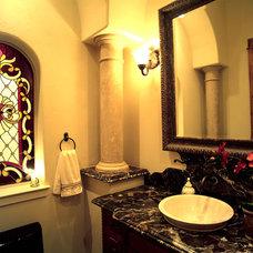 Mediterranean Powder Room by Asomoza Homes - Design Build