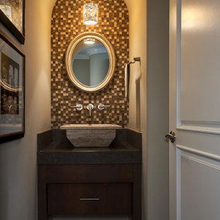 Design ideas for a small classic cloakroom in Orange County with flat-panel cabinets, dark wood cabinets, multi-coloured tiles, beige walls, ceramic flooring, a vessel sink, a one-piece toilet, solid surface worktops and mosaic tiles.