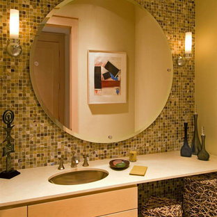Inspiration for a classic cloakroom in Dallas with recessed-panel cabinets, light wood cabinets, multi-coloured tiles, mosaic tiles and a submerged sink.