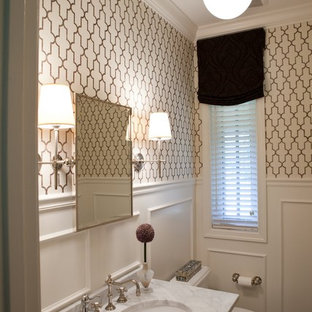Design ideas for a traditional powder room in Baltimore with marble benchtops and white benchtops.