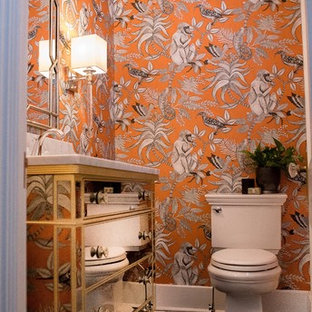 Inspiration for a small classic cloakroom in Other with freestanding cabinets, a two-piece toilet, orange walls, slate flooring, a submerged sink, marble worktops and black floors.
