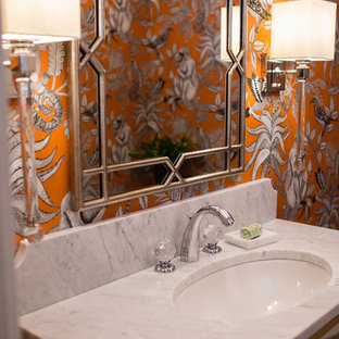 Design ideas for a small classic cloakroom in Other with freestanding cabinets, a two-piece toilet, orange walls, slate flooring, a submerged sink, marble worktops and black floors.