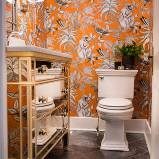 Small classic cloakroom in Other with freestanding cabinets, a two-piece toilet, orange walls, slate flooring, a submerged sink, marble worktops and black floors.