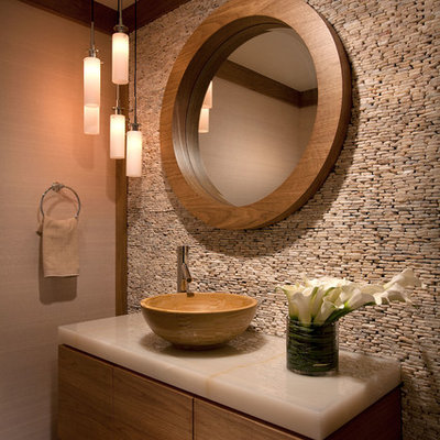 Example of a transitional powder room design in Miami with a vessel sink and beige countertops