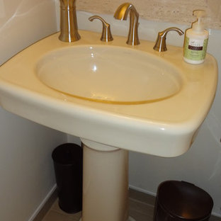 Small modern cloakroom in Toronto with a pedestal sink, a two-piece toilet, white walls and ceramic flooring.