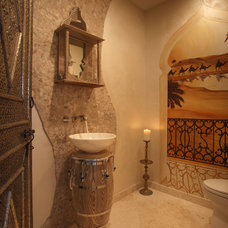 Mediterranean Powder Room by Brown's Interior Design