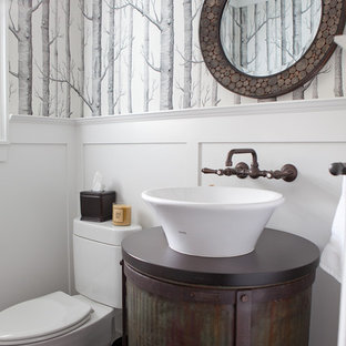 Design ideas for an industrial powder room in Portland with a vessel sink.