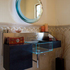 eclectic powder room by Jochum Architects