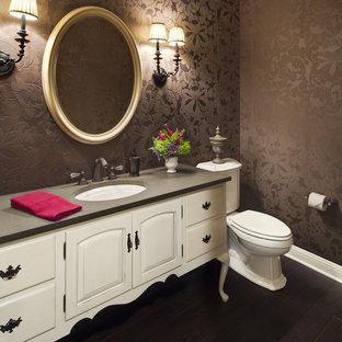 На фото: туалет в классическом стиле с врезной раковиной, фасадами островного типа, бежевыми фасадами и серой столешницей с