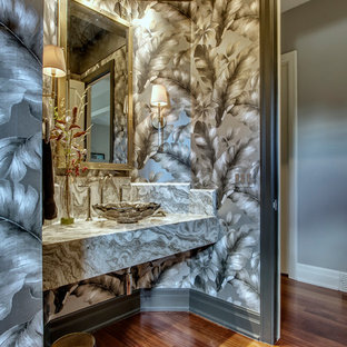 Design ideas for a small classic cloakroom in Calgary with shaker cabinets, black cabinets, a one-piece toilet, multi-coloured tiles, marble tiles, black walls, medium hardwood flooring, a vessel sink, marble worktops and red floors.