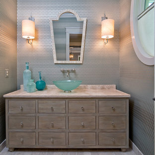 This is an example of a transitional powder room in DC Metro with a vessel sink and beige benchtops.