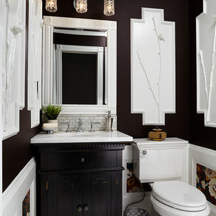 Inspiration for a small traditional cloakroom in Minneapolis with a submerged sink, beaded cabinets, dark wood cabinets, marble worktops, a two-piece toilet, multi-coloured tiles, mosaic tiles, brown walls and marble flooring.