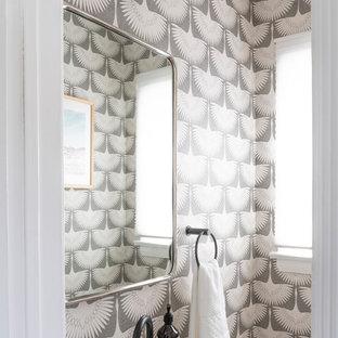 На фото: маленький туалет в стиле ретро с серыми стенами и подвесной раковиной с