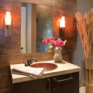 На фото: туалет в современном стиле с оранжевой плиткой и накладной раковиной