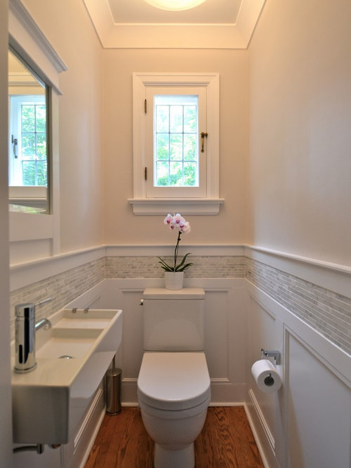 Example Of A Small Classic Gray Tile And Matchstick Tile Medium Tone Wood  Floor Powder Room