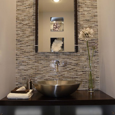 Minimalist powder room photo in Los Angeles with a vessel sink and brown countertops