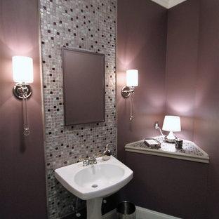 На фото: туалет среднего размера в стиле современная классика с разноцветной плиткой, плиткой мозаикой, розовыми стенами, раковиной с пьедесталом и столешницей из плитки