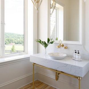 На фото: с высоким бюджетом туалеты среднего размера в стиле современная классика с унитазом-моноблоком, белой плиткой, белыми стенами, настольной раковиной, желтым полом и белой столешницей