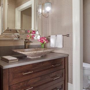 Inspiration pour un grand WC et toilettes traditionnel avec un placard à porte shaker, des portes de placard marrons, un mur beige, un sol en carrelage de céramique, une vasque, un plan de toilette en granite, un sol beige et un plan de toilette gris.