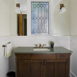 This is an example of an arts and crafts powder room in Chicago with an undermount sink, shaker cabinets, dark wood cabinets and green benchtops.