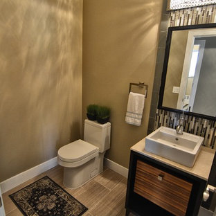 Photo of a small traditional cloakroom in Phoenix with flat-panel cabinets, multi-coloured tiles, glass sheet walls, grey walls, porcelain flooring, a pedestal sink, limestone worktops and grey floors.
