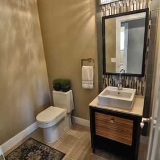 Design ideas for a small classic cloakroom in Phoenix with flat-panel cabinets, multi-coloured tiles, glass sheet walls, grey walls, porcelain flooring, a pedestal sink, limestone worktops and grey floors.