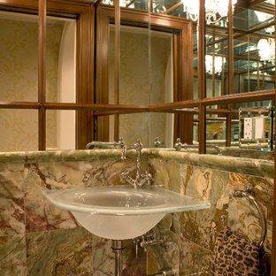 This is an example of a small eclectic cloakroom in Boston with multi-coloured tiles, marble tiles, marble flooring, a wall-mounted sink and multi-coloured floors.
