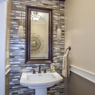 На фото: маленький туалет в современном стиле с разноцветной плиткой, разноцветными стенами, полом из керамогранита, раковиной с пьедесталом и удлиненной плиткой с
