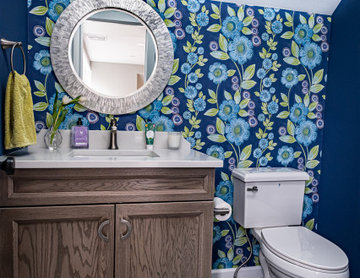 Powder Room with Floral Wallpaper and Wood Vanity