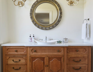 Powder Room with Furniture-Style Vanity and Ornate Mirror