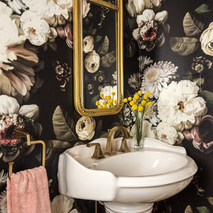 Small eclectic powder room photo in St Louis with multicolored walls and a pedestal sink