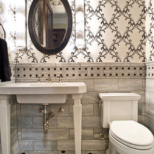 Small contemporary cloakroom in Other with a two-piece toilet, multi-coloured tiles, ceramic tiles, multi-coloured walls, porcelain flooring, a pedestal sink and multi-coloured floors.