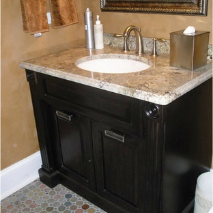 Traditional cloakroom in Chicago with raised-panel cabinets, multi-coloured tiles, mosaic tiles, slate flooring, granite worktops and distressed cabinets.