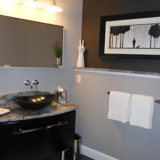 Powder room - mid-sized contemporary porcelain tile powder room idea in DC Metro with a vessel sink, flat-panel cabinets, black cabinets, marble countertops and gray walls
