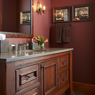 This is an example of a medium sized traditional cloakroom in Minneapolis with freestanding cabinets, red walls, slate flooring, a submerged sink, medium wood cabinets, concrete worktops and grey floors.