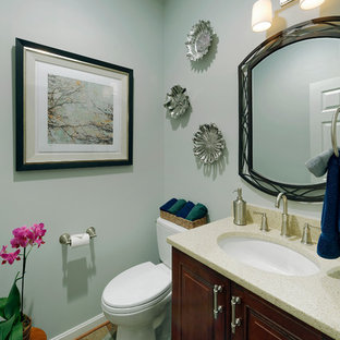 Medium sized classic cloakroom in DC Metro with a submerged sink, raised-panel cabinets, dark wood cabinets, engineered stone worktops, a two-piece toilet, blue walls, beige tiles, brown tiles and slate flooring.