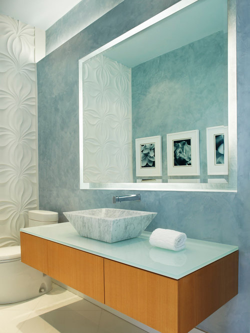 contemporary powder room idea in miami with a vessel sink and glass countertops