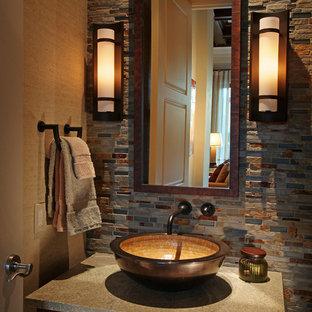 マイアミのトランジショナルスタイルのおしゃれなトイレ・洗面所 (ベッセル式洗面器、フラットパネル扉のキャビネット、濃色木目調キャビネット、マルチカラーのタイル、スレートタイル、グレーの洗面カウンター) の写真