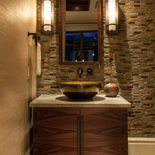 Tuscan powder room photo in Miami with a vessel sink