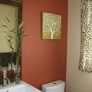 Small Trendy Powder Room Photo In New York With Flat Panel Cabinets Dark Wood