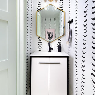 Medium sized contemporary cloakroom in Toronto with freestanding cabinets, white cabinets, cement flooring, green floors, white worktops, white walls and a console sink.
