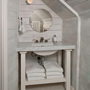 Inspiration pour un WC et toilettes marin avec un lavabo encastré, un placard sans porte, des portes de placard beiges et un plan de toilette gris.